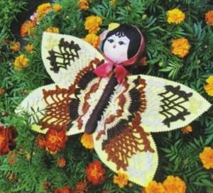 Ажурная бабочка с головой от куклы